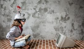 Portrait of young child pretend to be businessman. Kid with toy virtual reality headset in modern loft office. Success, creative and innovation technology concept. Copy space for your text