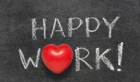 happy work exclamation handwritten on blackboard with heart symbol instead O