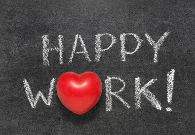 happy work exclamation handwritten on blackboard with heart symbol instead O